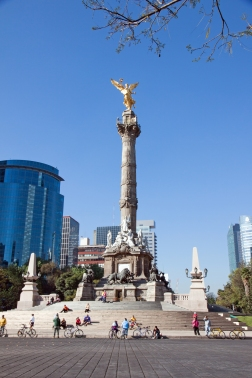 MEXICO CITY - FEBRUARY 3, 2013:The Angel of Independence, officially known as a victory column located on a roundabout over Paseo de la Reforma in downtown Mexico City on a sunday day